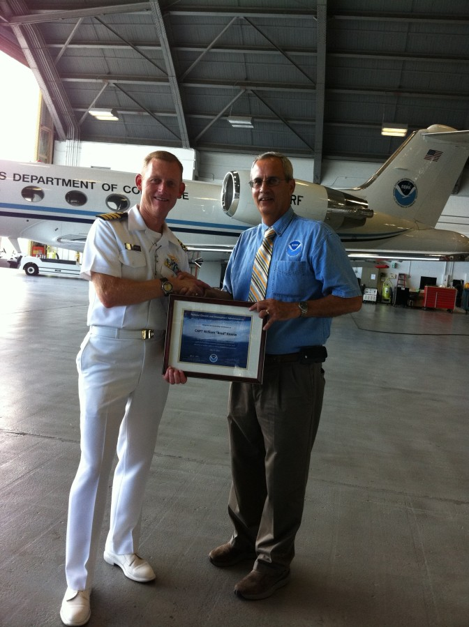 CAPT Brad Kearse (l) receives certificate of appreciation from Dr. Frank Marks (r)