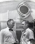 Dr. Simpson and R. Cecil Gentry in front of the original National Hurricane Research Project at West Palm Beach in 1956.