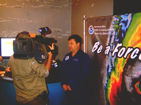 Eric Uhlhorn discusses hurricane science for the TV camera.
