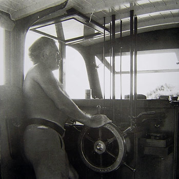 Ernest Hemingway at the helm of his boat Pilar