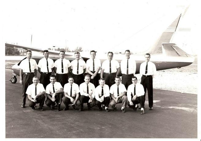 Research Flight Facility personnel Standing row (L - R): Bill Fitch (navigator), Don George (pilot - DC-6, C-54, B-26), John McCann (pilot - DC-6, C-54, B-26), Red Mettrick (pilot - DC-6), Pat Cunningham (pilot - B-57), Frank Cicirelli (flight engineer DC-6 and C-130), Don Sitman (pilot - DC6), Bob Loomis (pilot - DC-6). Kneeling row (L - R): John Zubritski (B-57 crew chief), Al Ricci (flight engineer - DC-6 and C-130) Jack Lubin (navigator ), Unknown, Brad Patten (flight engineer and instrument fabricator), Tommy Palmer (B-26 crew chief/flight engineer), and American Airmotive manager
