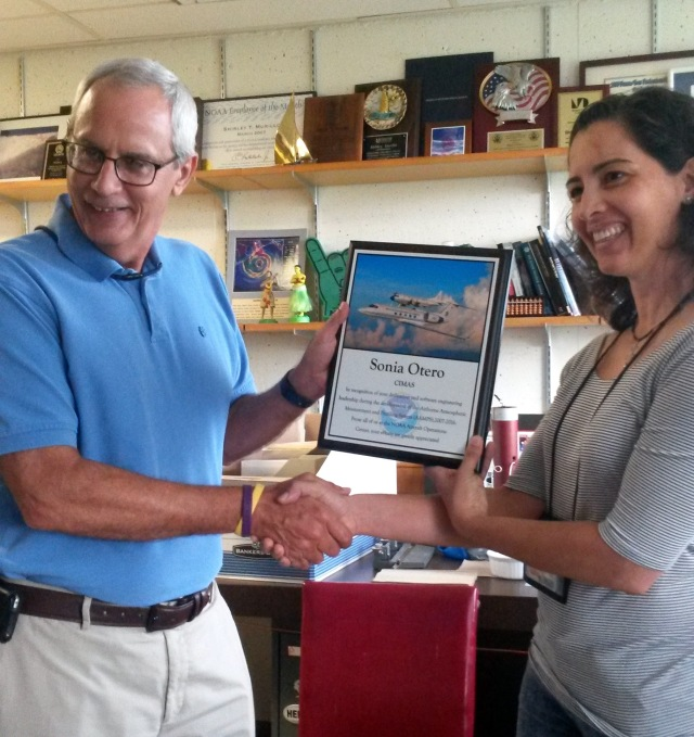 HRD Director Frank Marks presents the plaque to Sonia for AOC