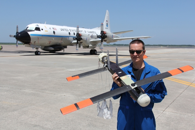 joe-cione-and-coyote-uas-with-p-3-on-tarmac-at-macdill-afb-credit_-noaa.jpg